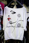 A t-shirt with a poorly worded English phrase for sale in a Chinese textile market in Hainan island. T-shirts with English phrases, or other languages, are popular in China, but often are misspelled or worded incorrectly.