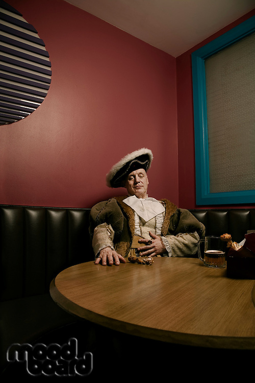King Henry VIII relaxing after meal in cafe