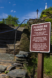 "A sign warning visitors to ""Please Be Careful"" while climbing 19th Century hand cut steps up from High Street to Jefferson Rock along the Appalachian Trail,  Harpers Ferry National Historical Park, Harpers Ferry, West Virginia..Harpers Ferry National Historical Park is located at the confluence of the Potomac and Shenandoah rivers in and around Harpers Ferry, West Virginia. The park includes land in the adjacent states of Maryland and Virginia. The park is managed by the National Park Service, an agency of the U.S. Department of the Interior. Originally designated a National Monument in 1944, the park was declared a National Historical Park by the U.S. Congress in 1963. The park includes the historic town of Harpers Ferry, notable as a center of 19th century industry and as the scene of John Brown's abolitionist uprising. The park was listed on the National Register of Historic Places on October 15, 1966."