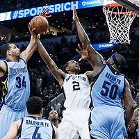 04 April 2017: San Antonio Spurs forward Kawhi Leonard (2) goes for the dunk over Memphis Grizzlies forward Zach Randolph (50), past Memphis Grizzlies forward Brandan Wright (34) during the San Antonio Spurs 95-89 OT victory over the Memphis Grizzlies, at the AT&T Center, San Antonio, Texas, USA.