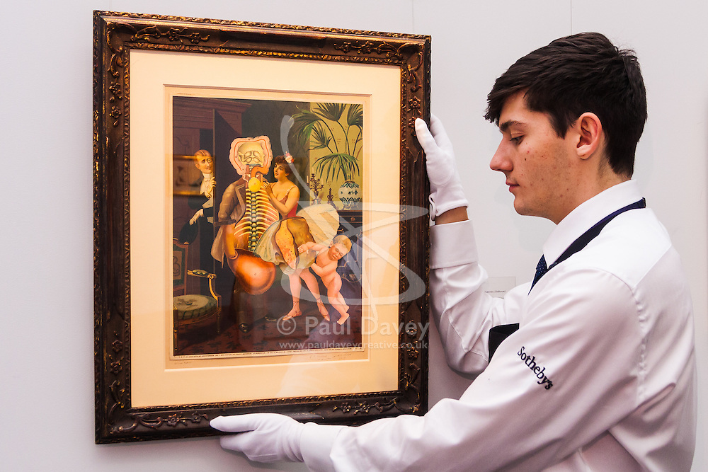 Sotheby's, Mayfair, London, November 7th 2014. Several outstanding examples of Czech avant-garde art from the Roy and Mary Cullen collection are to be auctioned by Sotheby's on November 12th. PICTURED: A Sotheby's worker adjust the hanging of an untitled collage by Styrsky, which is expected to fetch up to £120,000 at auction.
