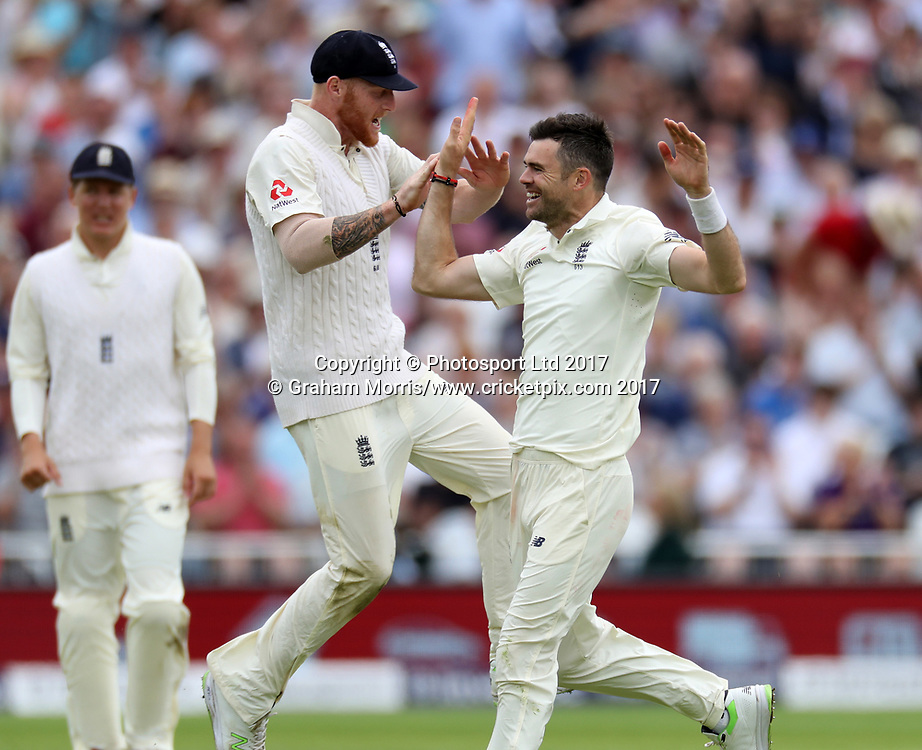 Bowler James Anderson celebrates removing Quinton de Kock with Ben Stokes (left) during the 2nd Investec Test Match between England and South Africa at Trent Bridge, Nottingham. Photo: Graham Morris/www.cricketpix.com / www.photosport.nz