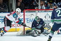 KELOWNA, CANADA - APRIL 25: Nick Merkley #10 of the Kelowna Rockets attempts a wrap around goal on Carl Stankowski #1 of the Seattle Thunderbirds on April 25, 2017 at Prospera Place in Kelowna, British Columbia, Canada.  (Photo by Marissa Baecker/Shoot the Breeze)  *** Local Caption ***