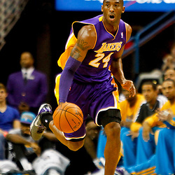 Dec 5, 2012; New Orleans, LA, USA; Los Angeles Lakers shooting guard Kobe Bryant (24) drives New Orleans Hornets during the first half of a game at the New Orleans Arena.  Mandatory Credit: Derick E. Hingle-USA TODAY Sports