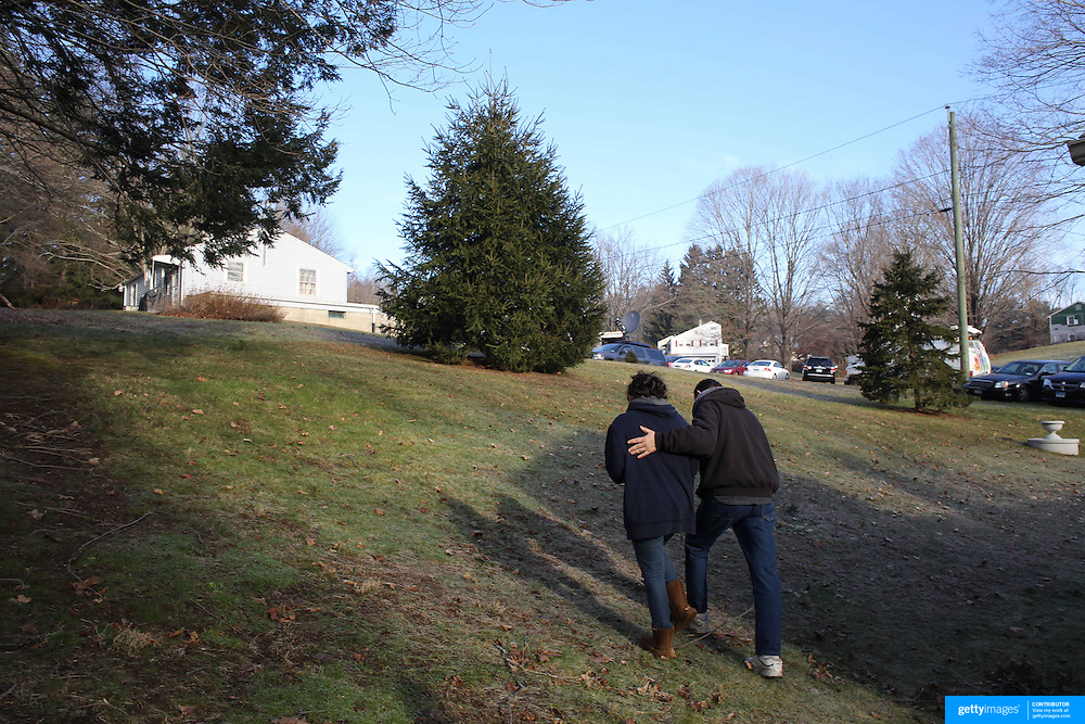 Ken and Rebecca Kowalski after visiting the school sign near the fire station after yesterday's shootings at Sandy Hook Elementary School, Newtown, Connecticut, USA. 15th December 2012. Photo Tim Clayton