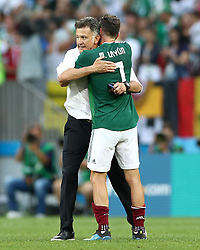 Mexico's Miguel Layun (right) embraces Mexico Manager Juan Carlos Osorio after the final whistle