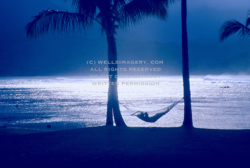 Image of hammock relaxation at the St. Regis Princeville Resort overlooking Bali Hai, Kauai, Hawaii, Hawaiian Islands, America West