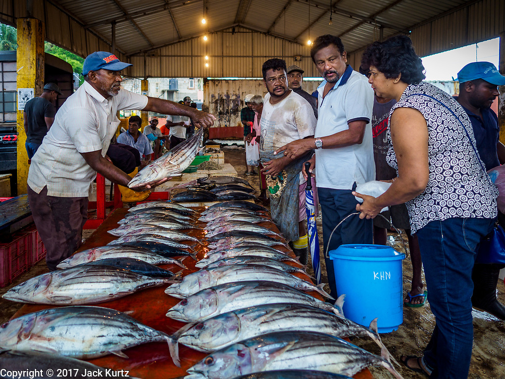 08 OCTOBER 2017 - NEGOMBO, WESTERN PROVINCE, SRI LANKA: People buying fish in a local fish market in Negombo, north of Colombo. Fish is an important source of protein for many Sri Lankans.    PHOTO BY JACK KURTZ