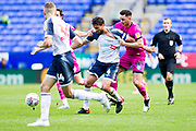 Rochdale forward Ian Henderson challenge Bolton Wanderers midfielder Jason Lowe  during the EFL Sky Bet League 1 match between Bolton Wanderers and Rochdale at the University of  Bolton Stadium, Bolton, England on 19 October 2019.