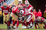 San Francisco 49ers defensive tackle DeForest Buckner (99) tackles Arizona Cardinals running back Adrian Peterson (23) at Levi's Stadium in Santa Clara, Calif., on November 5, 2017. (Stan Olszewski/Special to S.F. Examiner)