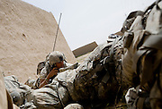 Under fire and pinned down, radio operator Private Luis Moreira of the 82nd Airborne, 1/508, Alpha Company, Third Platoon calls in for fire support in Sangin, Helmand province, Afghanistan on Thursday, April 5, 2007. The firefight, less than 24 hours into the air assault on Sangin raged for over five hours.