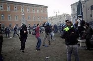 ITALY, Rome, October 15, 2011: Police officers clash with  protesters in front of the St. John in Lateran basilica during clashes in Rome, Saturday, Oct. 15, 2011.  © Christian Minelli/Emblema.