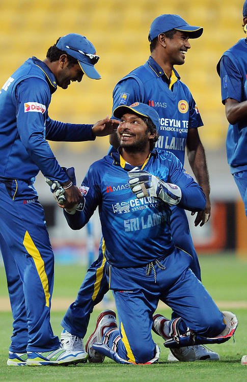 Sri Lanka's Kumar Sangakkara is congratulated by Dimuth Karunaratne after taking the catch to dismiss New Zealand's Corey Anderson for 29 in the 7th One Day International cricket match at Westpac Stadium, New Zealand, Sunday, January 29, 2015. Credit:SNPA / Ross Setford