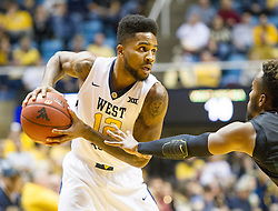 Nov 20, 2015; Morgantown, WV, USA; West Virginia Mountaineers guard Tarik Phillip looks to pass during the first half against the Stetson Hatters at WVU Coliseum. Mandatory Credit: Ben Queen-USA TODAY Sports