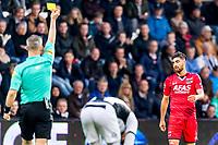 ALMELO - 14-04-2017, Heracles  Almelo - AZ, AFAS Stadion, AZ speler Alireza Jahanbakhsh krijgt de gele kaart van scheidsrechter Bjorn Kuipers