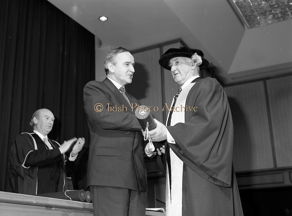 30/11/1992<br /> 11/30/1992<br /> 30 November 1992<br /> Conferring of Honorary Degrees (LL.D.) by the National Council for Educational Awards in Dublin Castle Conference Centre, Dublin. Picture shows Taoiseach Albert Reynolds, T.D. presenting Mr. Patrick Donegan with his degree.