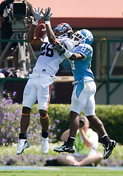 Virginia cornerback Chris Cook (26) breaks up a pass intended for North Carolina wide receiver Brandon Tate (87).  The North Carolina Tar Heels football team faced the Virginia Cavaliers at Kenan Memorial Stadium in Chapel Hill, NC on September 15, 2007.  UVA defeated UNC 22-20.