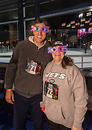 East Meadow, New York, USA. December 31, 2014. BRIAN FEFFERMAN and his wife HEATHER FEFFERMAN, of Easter Meadow, are wearing colorful decorative 2015 eyeglasses, and are runners who participate in a 5K New Year's Eve DASH to support the Long Island Council on Alcoholism and Drug Dependence (LICADD) at the Twin RInks Ice Center at Eisenhower Park in Long Island. A Skatin' New Year's Eve event started hours earlier and a New Year's Eve Party, open to runners, family and friends continued until 2:30 a.m.