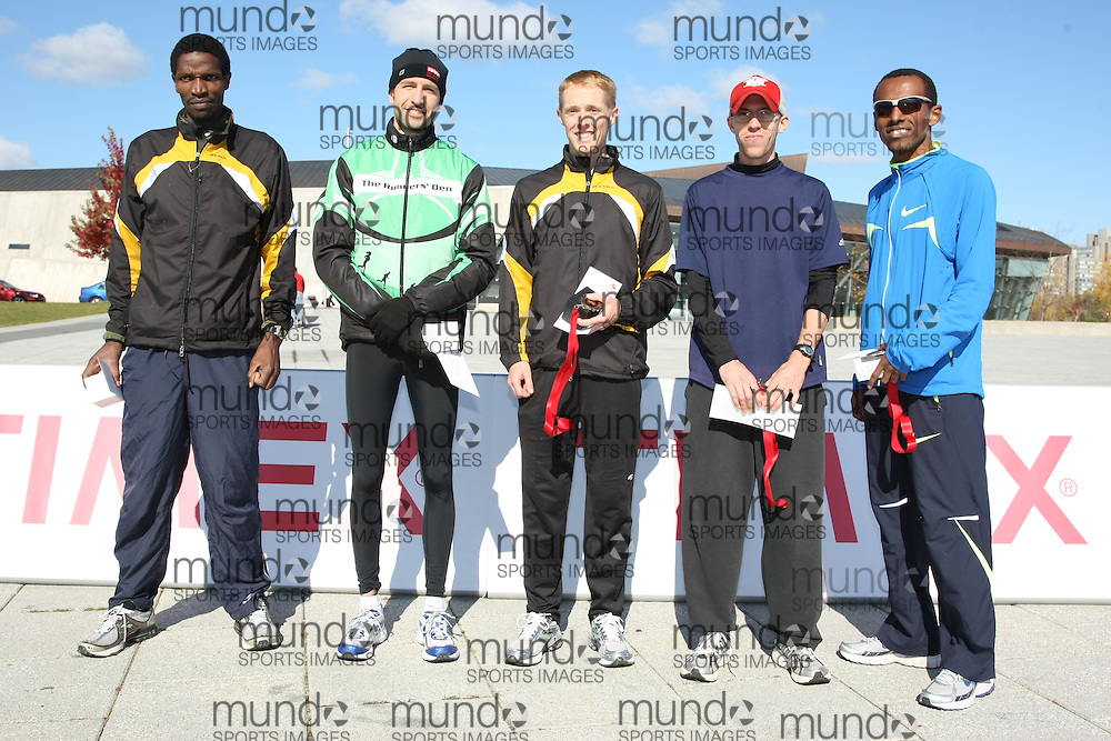 (Ottawa, ON---18 October 2008) The top finishers at the TransCanada 10k Canadian Road Racing Championships. From left to right: 5th--Giitah Macharia; 4th--Richard Mosley; 3rd--Eric Gillis; 2nd--Derek Nakluski; 1st--Simon Bairu. Photograph Geoff Robins/Mundo Sport Images (www.msievents.com).