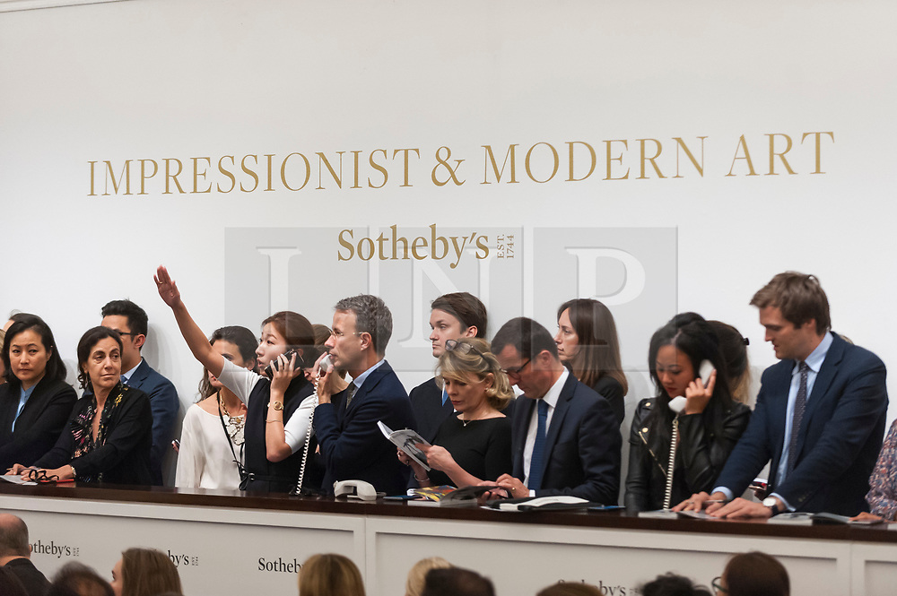 © Licensed to London News Pictures. 19/06/2018. LONDON, UK. Sotheby's staff make bids on behalf of telephone clients at Sotheby's Impressionist & Modern art evening sale in New Bond Street.  Photo credit: Stephen Chung/LNP
