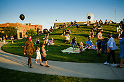 21 JULY 2020 - DES MOINES, IOWA: People gather in Pappajohn Sculpture Park Tuesday evening. About 300 people attended a vigil for the late Representative John Lewis (D-GA) in the Des Moines park Tuesday night. Rep. Lewis died from pancreatic cancer on July 17, 2020.             PHOTO BY JACK KURTZ