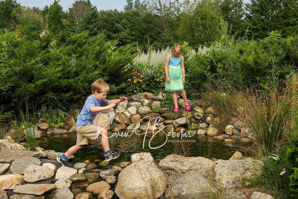 Matthew and Miya Papenhausen explore the ponds at Moulton Farm following Sunday brunch with their family.  (Karen Bobotas/for the Laconia Daily Sun)