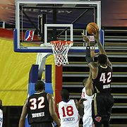 Erie BayHawks Forward Alex Oriakhi (42) shoots the ball as Delaware 87ers Forward JR Inman (33) defends in the first half of a NBA D-league regular season basketball game between Delaware 87ers (76ers) and the Erie BayHawks (Knicks) Friday, Jan. 3, 2014 at The Bob Carpenter Sports Convocation Center, Newark, DE