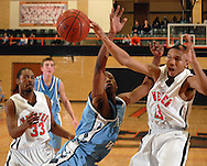 4 FEB. 2010 -- WEBSTER GROVES, Mo. -- Parkway West's Charles Thomas (15) battles Webster Groves Demetrius Robinson (33, CQ) and Rayshawn Simmons (13) during  the game Thursday, Feb. 4, 2010 between Webster Groves and Parkway West at Webster Groves High School. Photo (c) copyright by Sid Hastings.