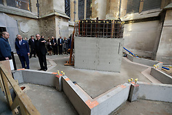 The Prince of Wales (second left) is shown the area around a foundation stone, on which he unveiled a plaque, for a new stair and lift tower by the Dean of Westminster John Hall (third left) during his visit to the The Queen's Diamond Jubilee Galleries at Westminster Abbey in London.
