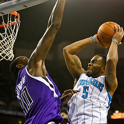 December 15, 2010; New Orleans Hornets guard Marcus Thornton (5) shoots over Sacramento Kings center Samuel Dalembert (10) during the first half at the New Orleans Arena.  Mandatory Credit: Derick E. Hingle