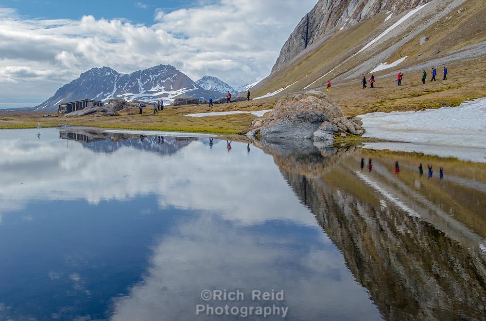 Reflection of Wilhelm Matheson trappers cabin from 1930s at Gnålodden in Hornsund in Southwestern Spitsbergen in Svalbard, Norway.