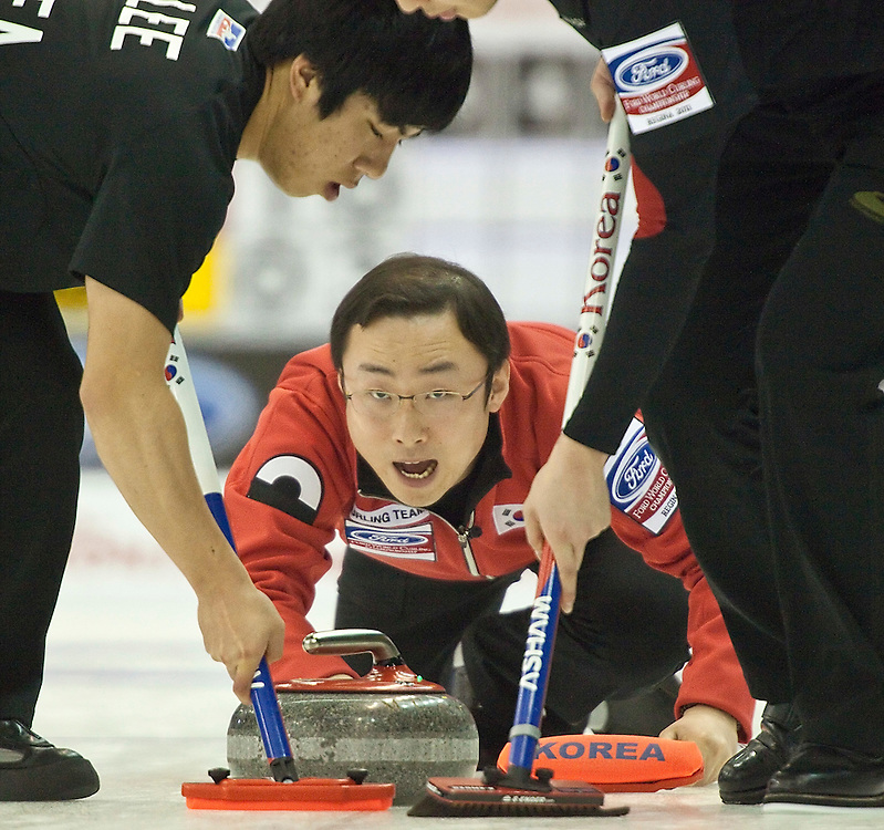 South Korea's skip Dong Keun Lee delivers a shot during Korea's match against Switzerland in the evening draw at the Ford World Men's Curling Championships at the Brandt Centre in Regina, Saskatchewan, April 7, 2011.<br /> AFP PHOTO/Geoff Robins