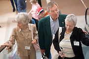 18660Golden Reunion, class of 1958: Tour of Baker Center..Senator George Voinovich  & Mrs. Voinovich ride escalator with Betsy Kean
