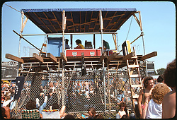 The Lighting & Sound Booth before the Grateful Dead Concert begins at Roosevelt Stadium on 4 August 1976. Candace Brightman can be seen tweaking her magic at the board on the right. Unknown sound crew on the left.