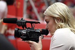 17 January 2015:  Katy Winge (a current Illinois State women's basketball player) handles a video camera for TV10 during an NCAA MVC (Missouri Valley Conference men's basketball game between the Bradley Braves and the Illinois State Redbirds at Redbird Arena in Normal Illinois