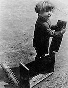 Street urchin with crate