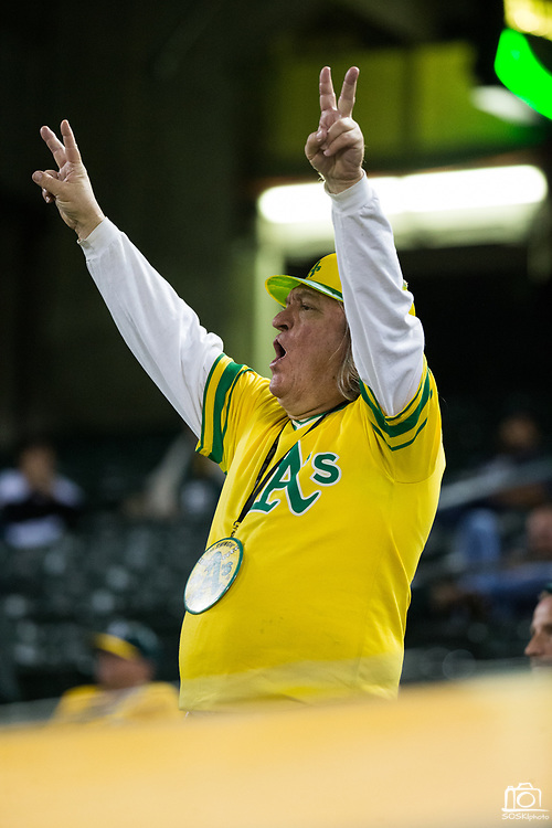 An Oakland Athletics fan reacts to gameplay against the Los Angeles Angels at Oakland Coliseum in Oakland, California, on September 5, 2017. (Stan Olszewski/Special to S.F. Examiner)
