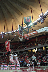 15 February 2014:  Tyshon Pickett gets some serious air as he lays the ball towards the hoop during an NCAA Missouri Valley Conference (MVC) mens basketball game between the Bradley Braves and the Illinois State Redbirds  in Redbird Arena, Normal IL.