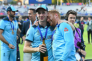 Chris Woakes of England and Jonny Bairstow of England on the lap of honour after winning the Cricket World Cup during the ICC Cricket World Cup 2019 Final match between New Zealand and England at Lord's Cricket Ground, St John's Wood, United Kingdom on 14 July 2019.