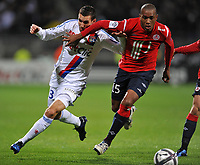 FOOTBALL - FRENCH CHAMPIONSHIP 2010/2011 - L1 - OLYMPIQUE LYONNAIS v LILLE OSC - 17/10/2010 - ANTHONY REVEILLERE (LYON) - EMERSON DA CONCEICAO (LILLE)<br />  - PHOTO FRANCK FAUGERE / DPPI