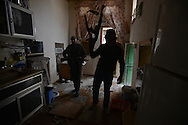 Aleppo, Syria, January 2013 -  Free Syrian Army rebels storm a house as they chase soldiers from the Syrian Army during a heavy fight for control an area of the Old City section of Aleppo. The rebels lost one fighter during the operation. (Photo by Miguel Juárez Lugo)