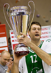 Goran Jagodnik of Olimpija celebrates with a trophy after the basketball match between KK Union Olimpija Ljubljana and KK Krka Novo mesto in Final match of 11th Slovenian Spar Cup 2012, on February 19, 2012 in Sports hall Brezice,  Brezice, Slovenia. Union Olimpija defeated Krka 68-63 and became Slovenian Cup Champion 2012. (Photo By Vid Ponikvar / Sportida.com)