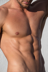 detail of a muscular man's torso