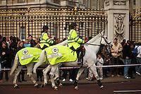 Policewomen on horseback in front of Buckhingham Palace, London, England.