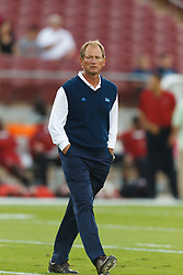 Oct 1, 2011; Stanford CA, USA;  UCLA Bruins head coach Rick Neuheisel watches his team warm up before the game against the Stanford Cardinal at Stanford Stadium.  Mandatory Credit: Jason O. Watson-US PRESSWIRE