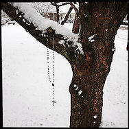NEWTOWN, CT-10 December 2013- A single Rosary hangs from a tree in front of the St. Rose of Lima Catholic Church in Newtown. The church was the site for many of the funerals and memorials following the tragic shootings last December. Residents are hoping for a return to life before the tragedy as the small New England town prepares for the anniversary of the Sandy Hook Elementary School shooting of December 14, 2012.  (Photo by Robert Falcetti)