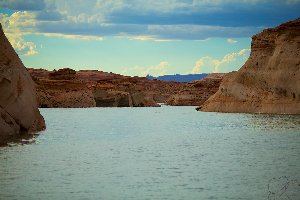 Afternoon showers starting to form over Lake Powell as the view from the endless Canyons give you a unique view of the horizion