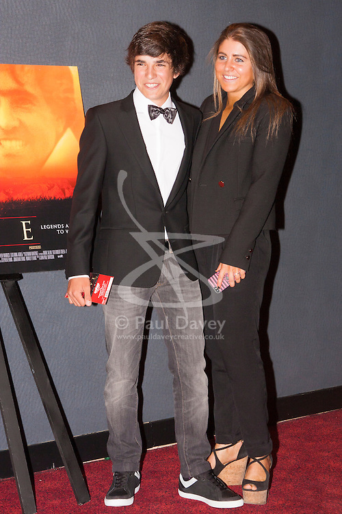 London, June 23rd 2014. Actor Jose Luis Gutierrez Real poses with Carmen, daughter of Seve Ballesteros at the premiere of the film Seve, a film about her father, the legendary Spanish golfer.