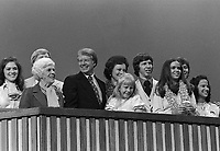 1976, Manhattan, New York, New York, USA --- Nominee Jimmy Carter stands at the podium with his family at the 1976 Democratic National Convention. --- Image by © Owen Franken/CORBIS