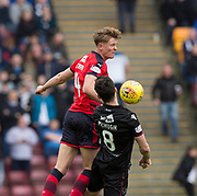 28th April 2018, Fir Park, Motherwell, Scotland; Scottish Premier League football, Motherwell versus Dundee; Mark O'Hara of Dundee competes in the air with Carl McHugh of Motherwell